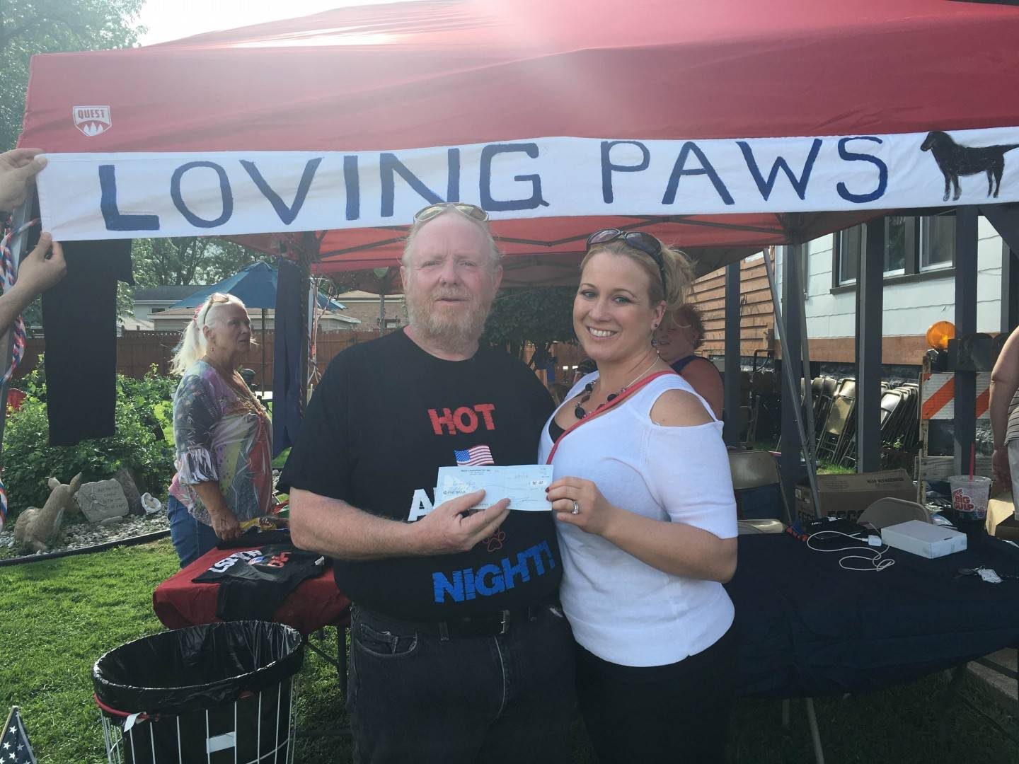 Donating at Loving Paws Fundraiser